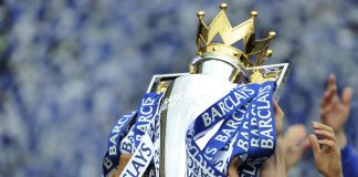 Chelsea players celebrate with trophy after win